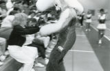 Willie the Wave greets a fan during a basketball game, 1988