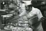 Cook preparing meals in cafeteria, 1988