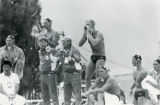 Players and coaches urge on the US national water polo team during an Olympic match, 1984