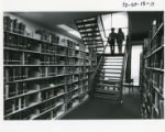 Students descending stairs in Payson Library, 1982