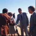 Jim Nabors greets Ronald Reagan during Pepperdine University tree planting dedication, 1973